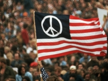 A peace sign printed on the American Flag is raised during a protest against the Vietnam War in Washington, D.C. (Photo: Archive / History Channel)