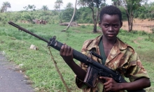 A 2000 image of a 14-year-old soldier in Sierra Leone Photograph: Adam Butler/AP