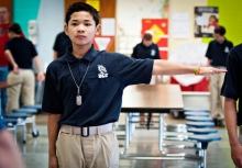 August Say, 12, holds out his arm to determine where he should stand in class in the new Dragon Leadership Corps at his middle school in Bowling Green, Ohio.